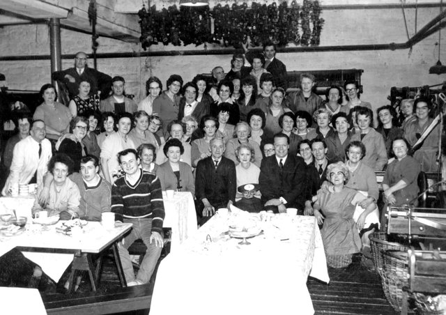 Group photo: This photograph was taken at one of the many parties held in the weaving shed at Crabtrees Mill, Dewsbury Moor, when Dorothy Wilson worked there. It is thought the picture might have been taken to celebrate the 80th birthday of the mill's owner, Mr Stanhope Crabtree, or the Coronation in 1951.