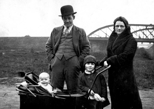 Dangerous times: The Hartley family from Savile Town who suffered more than most when the bombs dropped on Dewsbury during the war. Pictured are Mr and Mrs Dennis Hartley and their two daughters, Brenda, in the pram, and her sister Joyce, standing.
