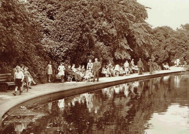Big attraction: A sunny day in Crow Nest Park, Dewsbury,  which was always the place to be in the 1950s when it is believed this picture was taken. The lake was always a big attraction, especially for the children. Picture kindly loaned by Stuart Hartley.