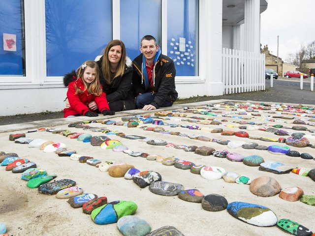 From the left, Chloe Addison, mum Kate Addison and dad Oliver Addison, with the Gomersal Rock Snake.