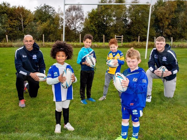 Chev Walker and Liam Kirk with Birkenshaw Blue Dogs 'pups' at East Bierley Community Sports Association