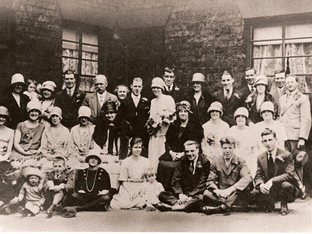 THE HAPPY COUPLE: Minnie Gallagher and Herbert Blacker, pictured with their families outside the home of Laura and Wilfred Gallagher.
