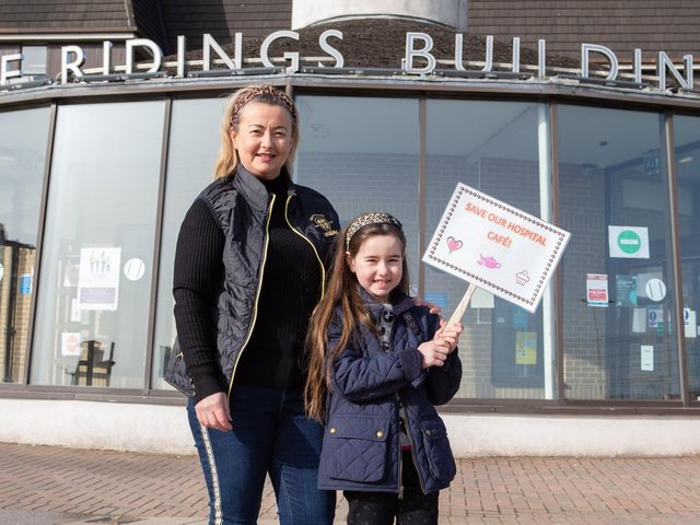 Claire Naughton and Lily Rose Beirne make a stand to help save the volunteer-run cafe at Dewsbury and District Hospital