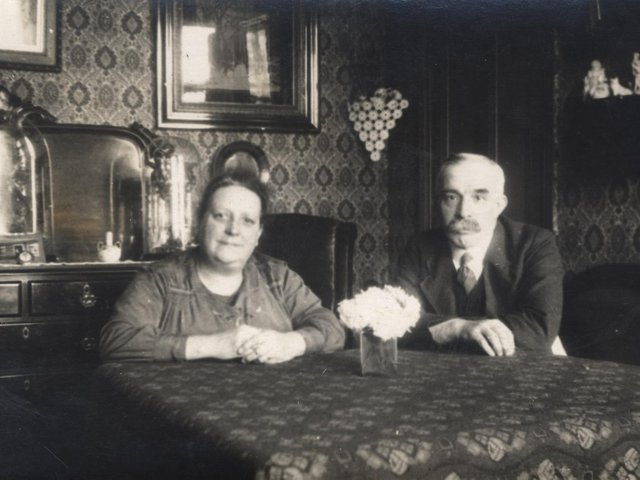 SIMPLE LIVING: Charlotte Sykes and her husband pictured in the 1930s in their home in Brook Street, Dewsbury, a back-to-back house which was demolished in the 1960s.
