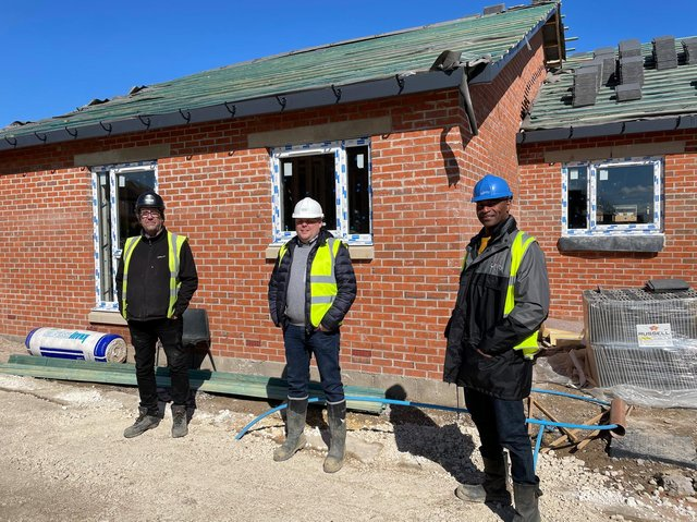 Wayne Noteman, Unity regeneration director (right) with Josh Paterson, Torpoint director (centre) and Mick Rogers, Torpoint site manager (left), outside one of the new Dale Lane properties which is nearing completion