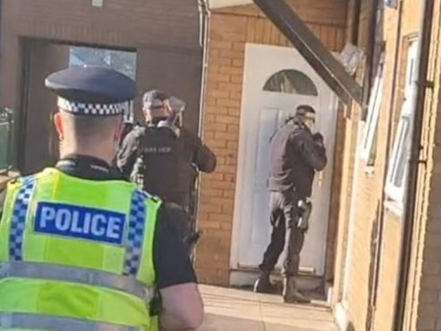 Police officers carrying out the raid on Wroe Street, Dewsbury
