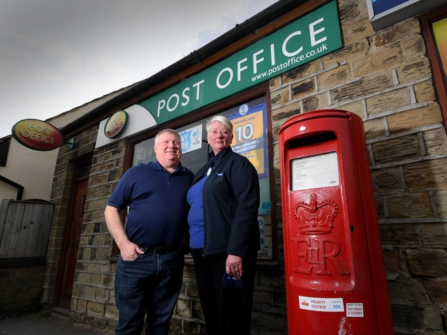 Alison Hall with her husband Richard, pictured outside the Post Office on Halifax Road, Liversedge