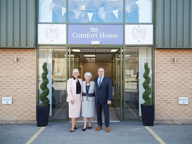 Pictured from the left are Debra Burrows (William Burrows' wife), Patricia Burrows (founder of HSL) and William Burrows (chairman and owner of HSL) in front of HSL headquarters in Batley
