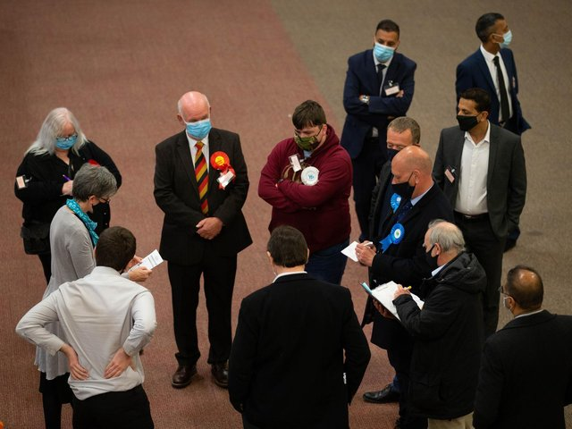 Candidates await the results at today's election count at Cathedral House in Huddersfield