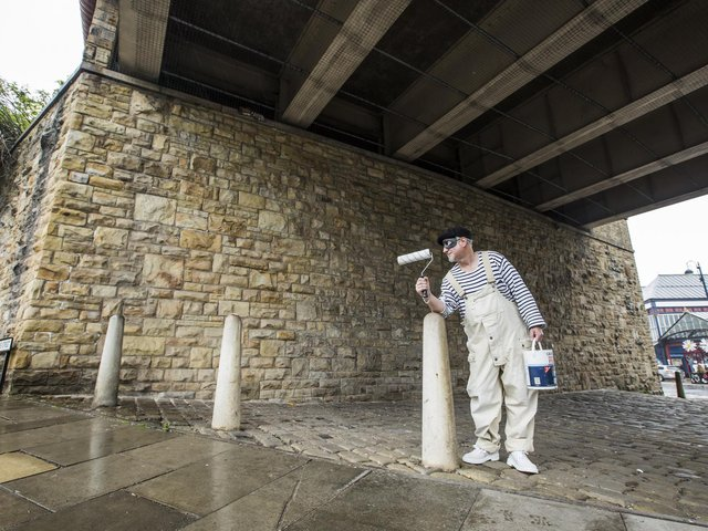 Street artist Trafford Parsons at the railway bridge where he plans to paint a mural.