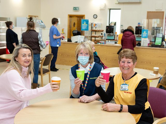 Clare Naughton, Lynda Dews and Rosemary Buckingham, volunteers at The Ridings voluntary cafe, celebrate being able to keep the cafe open at Dewsbury and District Hospital