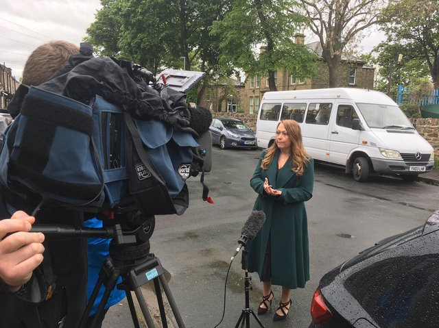 """Kirklees Council's director of public health, Rachel Spencer-Henshall, speaks to the media in Savile Town, Dewsbury, about the launch of """"surge testing"""" following a spike in coronavirus infection rates"""