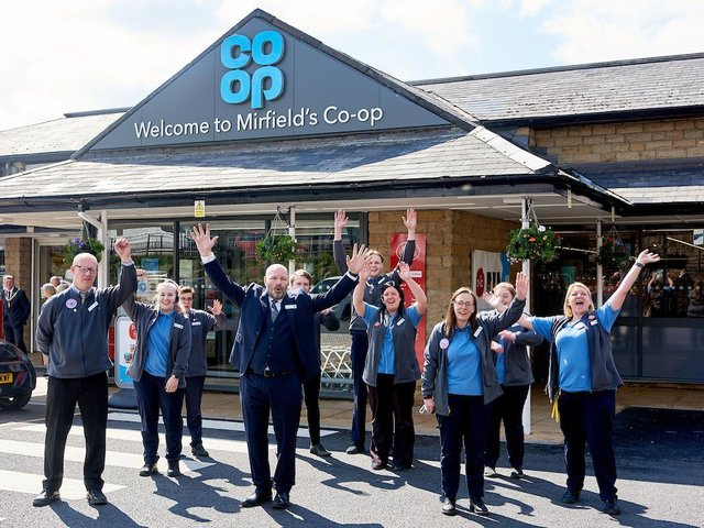 Staff celebrate the completion of a £1m makeover at Mirfield Co-op