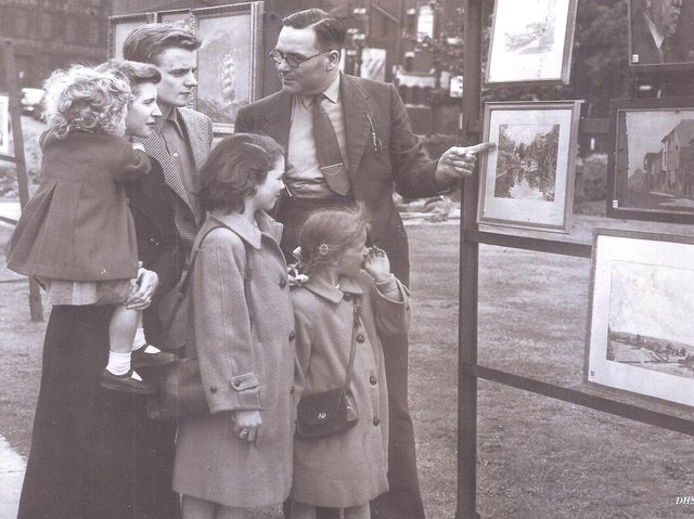 LONGCAUSEWAY: Mr Fred W Smith, former librarian and curator of Dewsbury Museum and Art Gallery, showing paintings done by local artists.