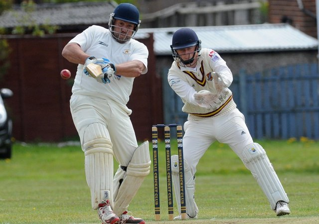 Birstall batsman Eric Austin on the attack.