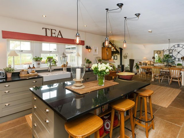 Sleek units, and plenty of light and space in this open plan kitchen