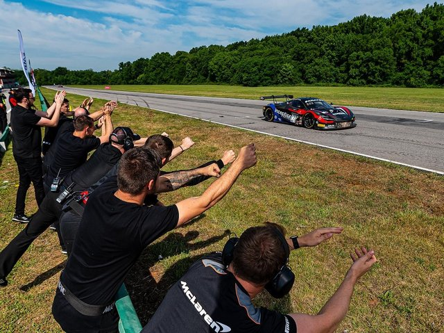 The inception team cheer on their driver at the International Raceway.