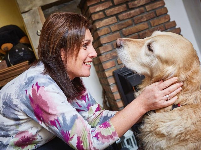 Lindsey Moore, of Gomersal, with her guide dog Charlotte, who passed away last year