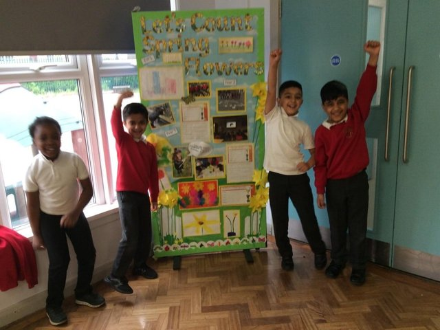 Children at Diamond Wood Community Academy, Ravensthorpe, with their floral-themed display