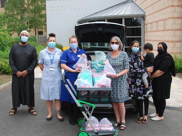Coun Jackie Ramsay, Haroon Kara, Hazra Roken and Firdows Lakha delivering pamper packs to the birthing centre at Dewsbury and District Hospital