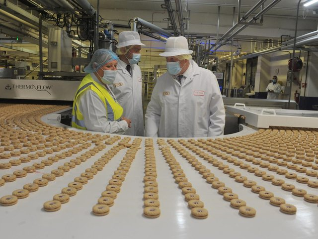 Prime Minister Boris Johnson visits the Fox's Biscuits factory in Batley with Ryan Stephenson, the Conservative candidate in the upcoming Batley and Spen by-election. Photo by Mike Simmonds