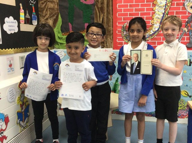Children at St John's Infant School, Dewsbury with their card from the Queen