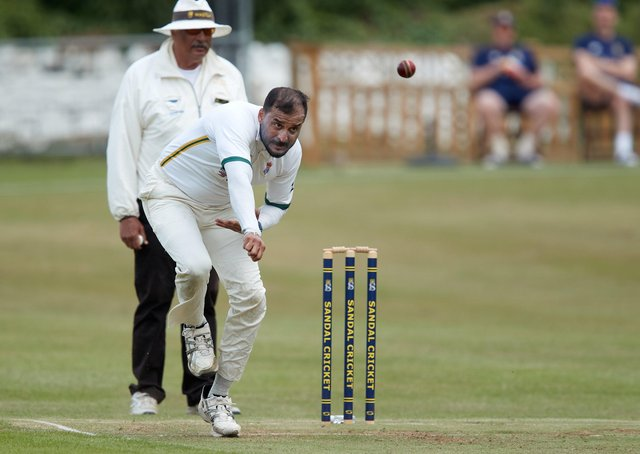 Spen Victoria's Abid Awan delivers on his way to taking 2-44 against Sandal. Picture: John Clifton