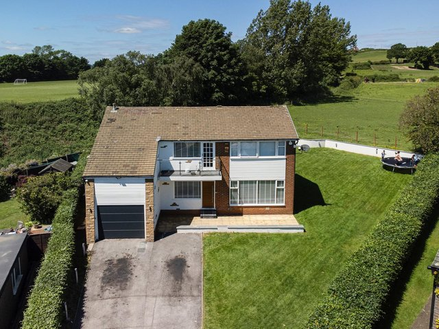 Gardens and rural surrounds with this detached family home