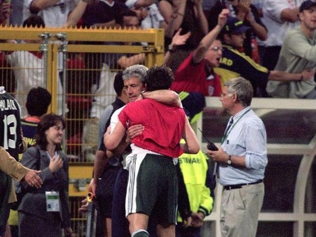 England coach Kevin Keegan consoles the German players after the European Championships 2000 group match at the Stade Communal in Charleroi, Belgium.