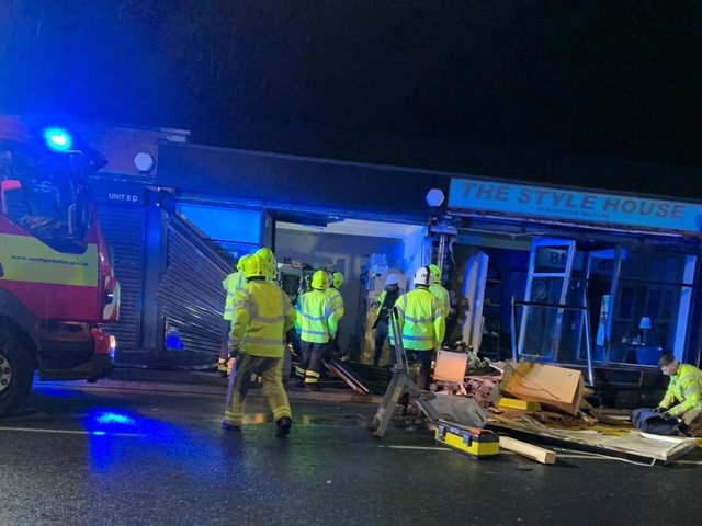 Two people were seriously injured when a BMW car crashed into a pet shop in Heckmondwike on Monday night (July 5)