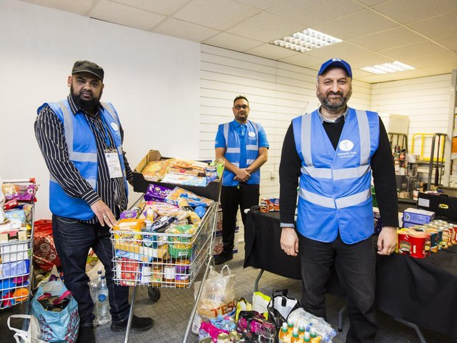 Pictured from the left are Idris Yousaf, Qumar Uddin and Arif Ahmad at Humanity First Food Bank in Mirfield.