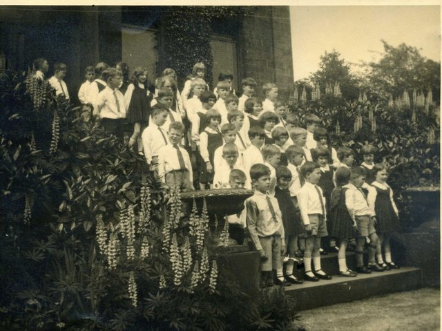 MARLBOROUGH SCHOOL: Children standing outside Marlborough House which at this time had been converted into a private school known as Marlborough School. Many of its pupils would later become pupils of Wheelwright Grammar School situated just across the road.