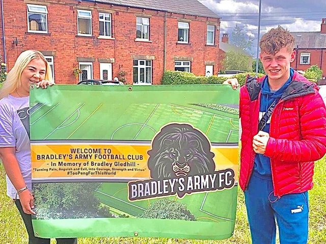 Bradley's sister Bryony Gledhill and his childhood best friend Kenny Wall with the banner for the newly formed Bradley's Army Football Club